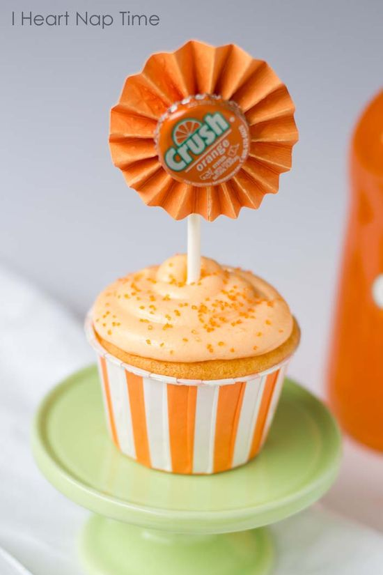 Orange crush cupcakes made with JELLO and topped with creamsicle frosting! These are to die for!