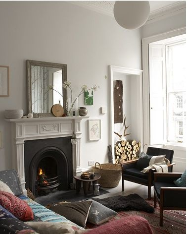 Papa Stour / Rosie Brown {eclectic townhouse living room} // that woodpile!