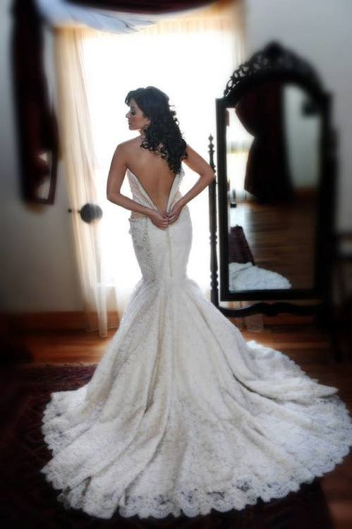 A happy bride looks great AND saves money on her wedding gown! If you're a bride on a budget click here to see inexpensive, yet beautiful, wedding gowns: www.outerinner.co... #OuterInner #WeddingGowns