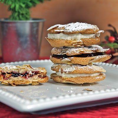 Almond Sandwich Cookies -- slivered almonds, almond paste, sugar, cinnamon,  egg whites, + jam and cream