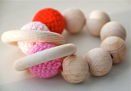 Teething toy with crochet red, pink and light pink wooden beads and 2 wooden rings. Wooden rattle. Gift for baby girl.