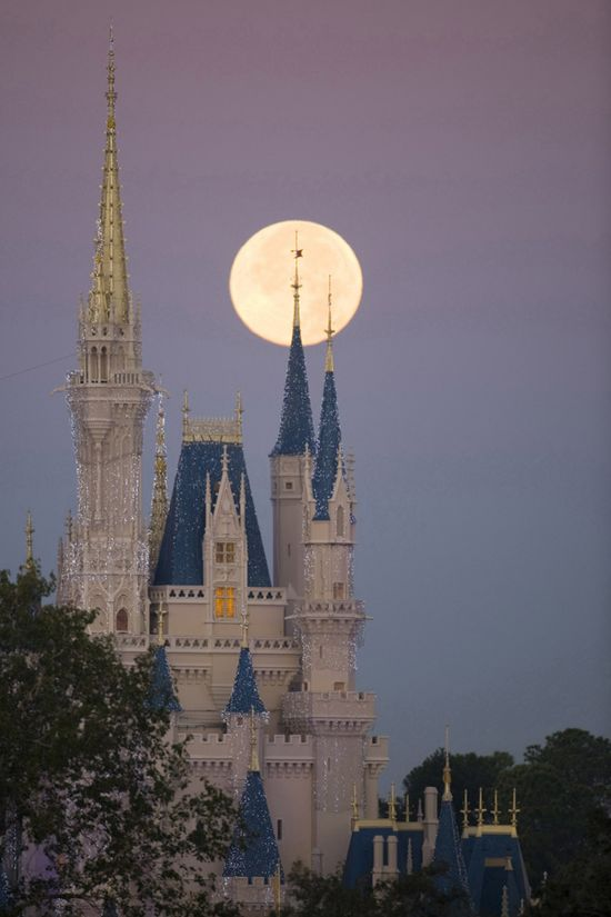 Full moon behind Cinderella's castle