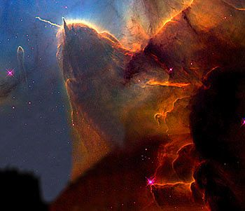 The Trifid Nebula. A 'stellar nursery', 9,000 light years from here, it is where new stars are being born
