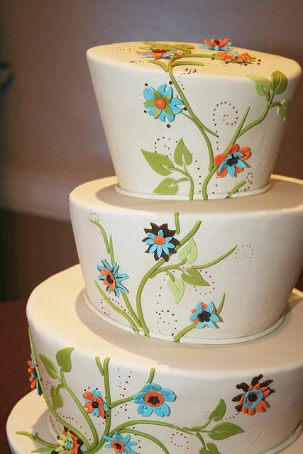 blue and orange flowers cake