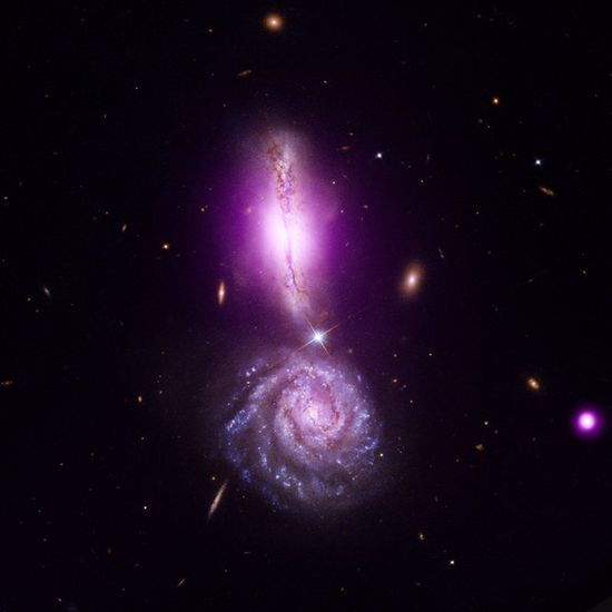 VV 340 Galaxy Collision Forms Exclamation Point Credit: X-ray NASA/CXC/IfA/D.Sanders et al; Optical NASA/STScI/NRAO/A.Evans et al  The deep space object VV 340, also known as Arp 302, is a textbook example of two colliding galaxies in a crash that will take millions of years. VV 340 is 450 million light-years from Earth. This image was released Aug. 11, 2011.