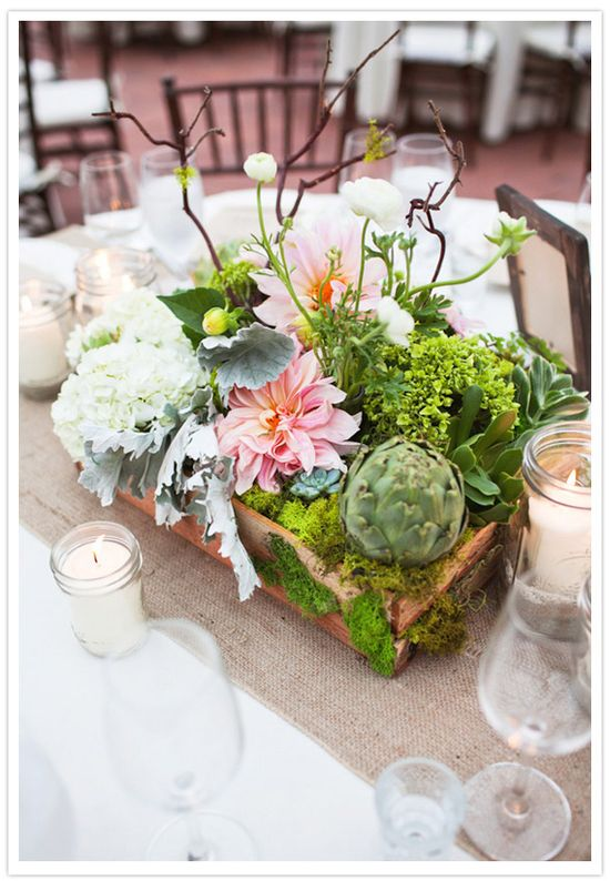 woodland centerpiece with flowers, moss, and succulents in a wood box