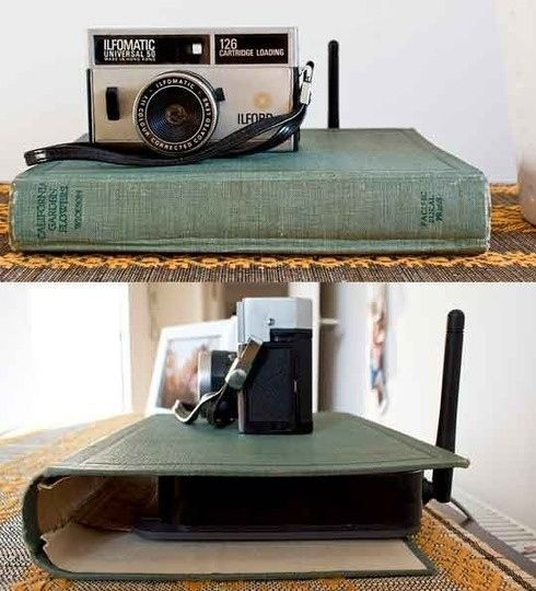 Use a hollowed out book to hide an unsightly router. If you're averse to the idea of desecrating books for the sake of home decor, try using a binder or a pretty photo album instead.