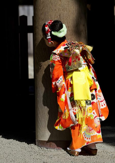 A girl in kimono for Shichi-go-san (traditional Japanese event to celebrate children's growth and pray for their future health and well-being).