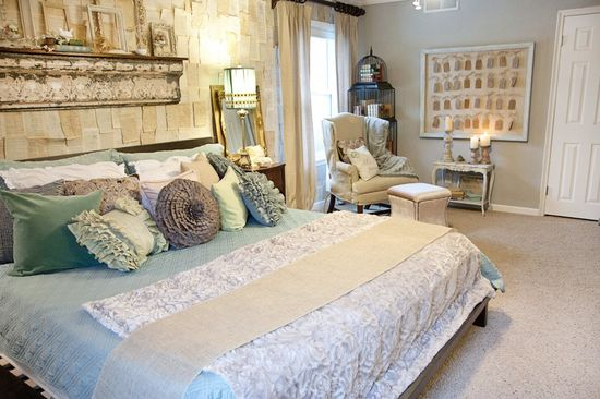 awesome anthro inspired bedroom with neutral color scheme and pops of blue