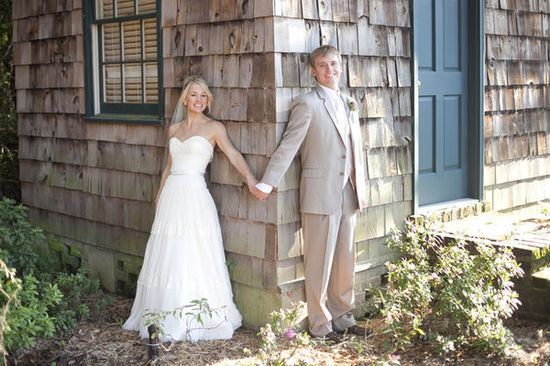 The couple wanted to get a picture before the wedding, but without seeing each other. So, the groom was blindfolded and led to the corner of the house, where the bride was waiting....CUTE idea!