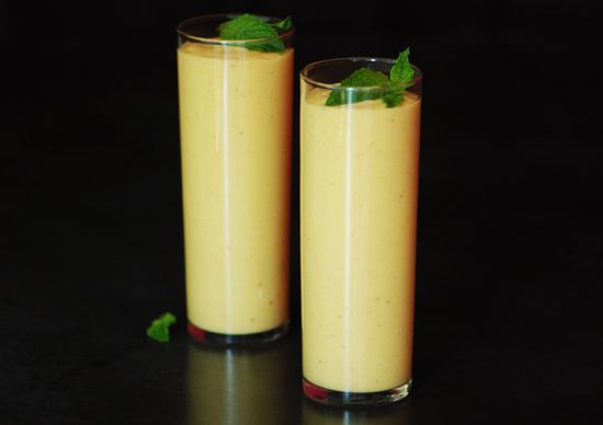 Mango-Peach Breakfast Lassi  Fresh ginger adds brightness and a hint of spice to this classic chilled yogurt drink popular in India. Make the lassi the night before and grab it on your way out the door to work for a quick and healthful breakfast smoothie.