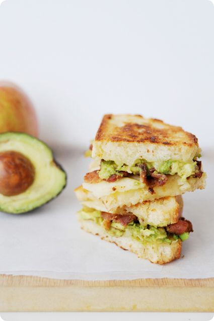 mini grilled cheese sandwich with avocado, bacon and apple slices.