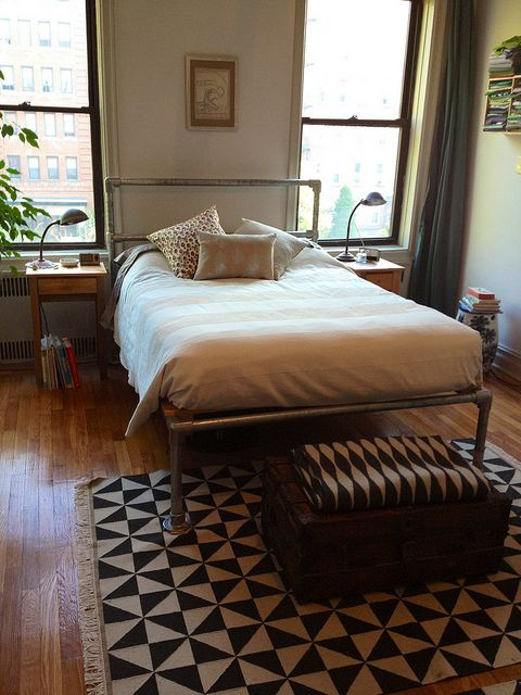 Build your own metal pipe bed frame -- interesting modern / industrial vibe. (Full instructions. Also has links to several canopy bed frames made of pipe!)