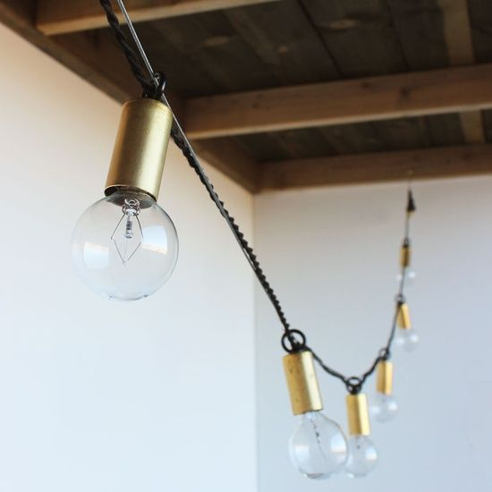 string lights with natural brass sockets and cloth twisted cord from one forty #kitchen decorating #kitchen design #kitchen decorating before and after