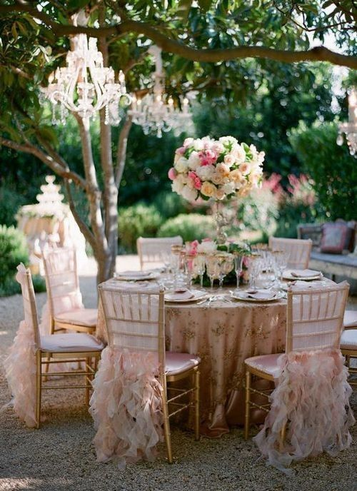 Those chair covers are fairly amazing and how can you not love chandeliers hanging from trees? Gorgeous.
