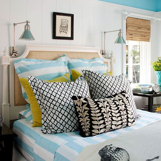 Cottage bedroom; fantastic headboard paired with charming sconces.