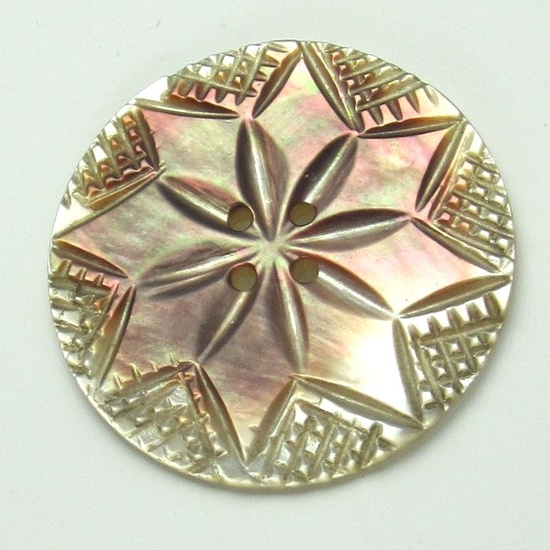 carved mother of pearl button