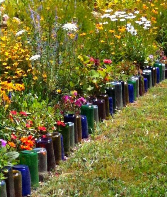 recycled glass bottles - the garden border I have been searching for! I could use clear bottles and paint the insides before putting them in the ground for a more universal look...