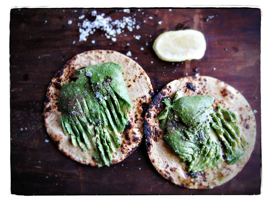 // Toasted corn tortillas toasted with mashed avocado, lime and sea salt.