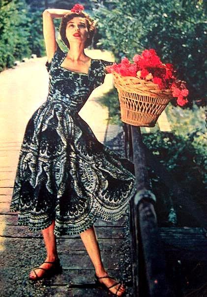 Dorian Leigh in a summer dress as seen in Elle, 1950