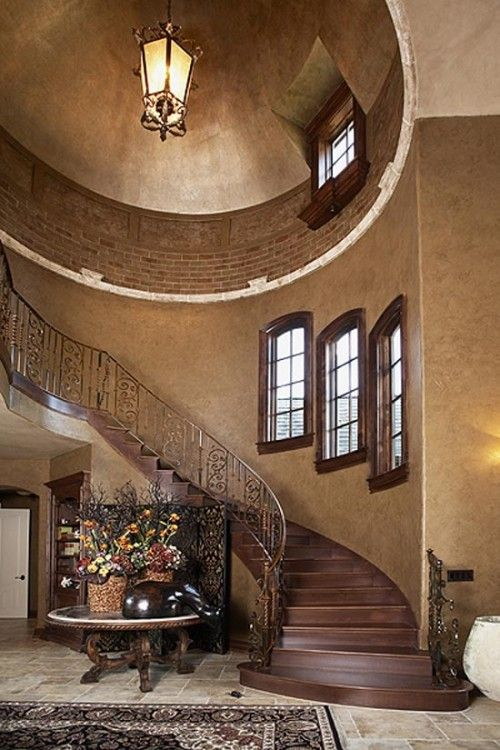 Beautiful staircase, love the color and wood and iron rail, ..
