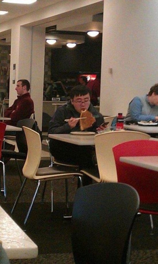 This kid eating pizza with chopsticks. Yep, a new level in pizza eating has been reached!