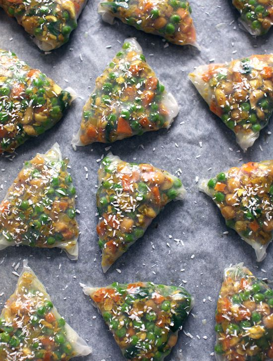 "Fully-loaded Spring Samosas Ingredients: 8 round rice paper wrappers (for spring rolls) 8.5""Filling knob of ghee or coconut oil 1 medium onion 2 cloves garlic 1 tsp. minced ginger ¾ tsp. sea salt ½ cup unsalted unroasted cashews ¼ cup unsweetened desiccated coconut 3 medium carrots 1 ½ / 250g cup green peas 1 cup chickpeas 2 cups / 75g firmly packed fresh baby spinach Spices 1 Tbsp. cumin seeds ½ Tbsp. mustard seeds ½ tsp. turmeric ½ tsp. coriander ¼ tsp. cardamom 1/8 tsp. cinnamon cayenne"