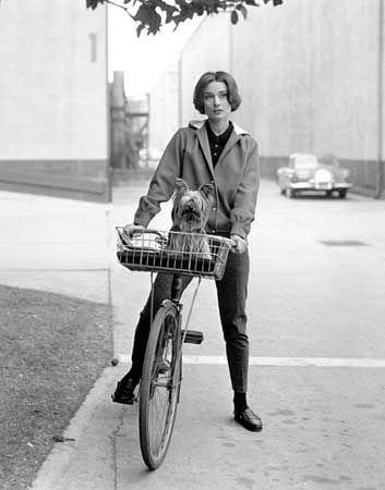 Audrey Hepburn riding a bike.