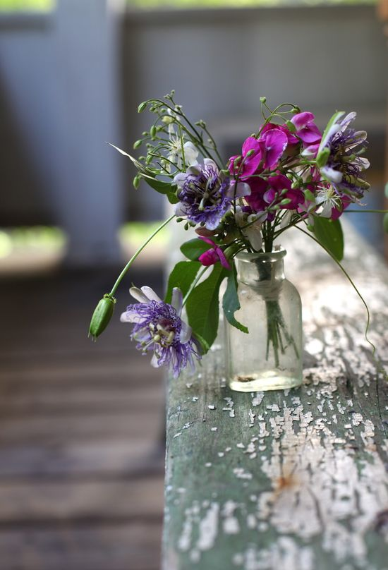 arrangement with passion flowers and sweet peas by Maggie Pate