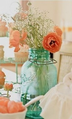 Mason Jar Flower Arrangement - for orange and blue themed sweet table