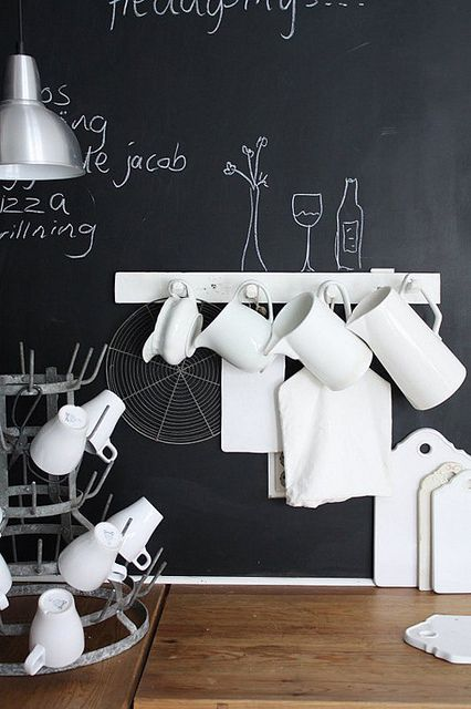 Chalkboard walls are great in the kitchen!   Recipes, doodles, to-do lists, dates or quotes to remember ...