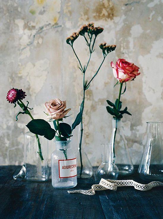 single flowers in glass bottles ?