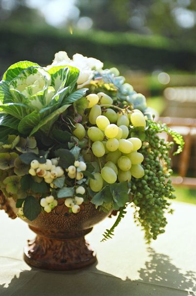 Grapes and kale mixed in with flowers and plants (grapes are in season August through September in MO)