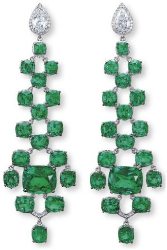 Unique emerald and diamond earrings. Each set with a pear-shaped diamond surmount weighing 0.71 and 0.71 carat, suspending a cascade of cushion-shaped emeralds, centered with a larger cushion-shaped emerald weighing 5.99 and 5.68 carats, to the reverse pavé-set diamond detail, mounted in 18k white gold,  Via Diamonds in the Library.