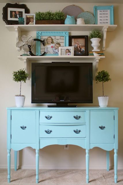A Diamond in the Stuff: Living Room Makeover {Open Shelving} I love the way she has styled around the TV so it becomes part of the decor.