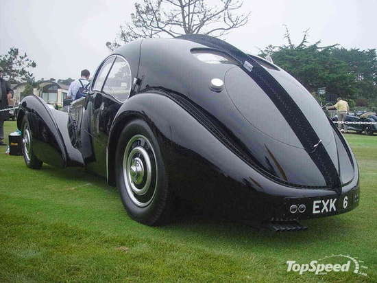 Bugatti car built in 2 halves and riveted down the center.  An original goes for 34$ million.