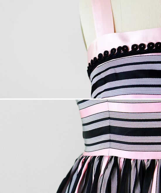 details on a vintage 1950s circus stripes party dress.