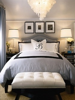 gray, black and white master bedroom - love the bench at the end of the bed & the initial on pillow