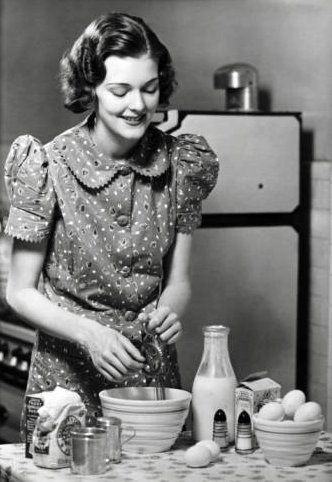 A cheerful 1930's housewife whips up something yummy