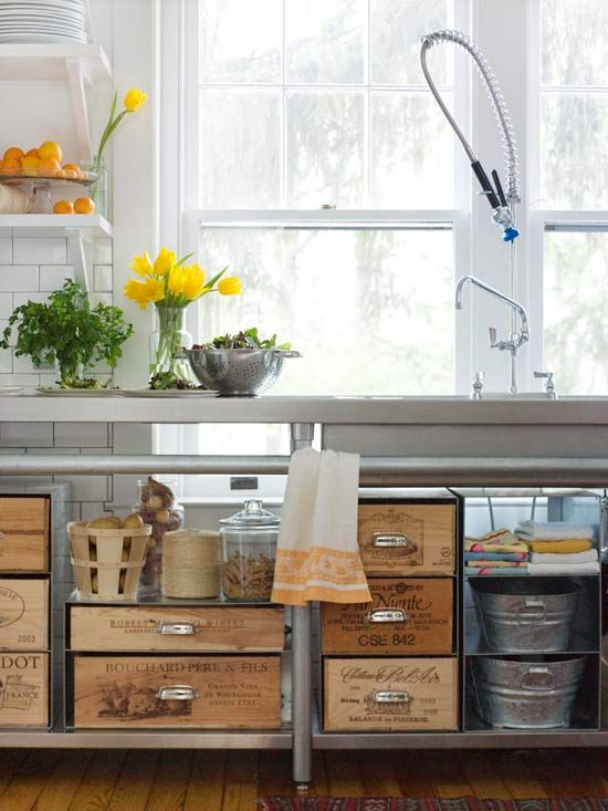 Wooden Crate Storage - Turn wooden crates into unique kitchen storage by adding drawer pulls, which makes it easier to pull the crates out from the shelves. The crates and metal countertops work together for a vintage, industrial vibe.