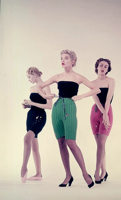"""Models are wearing knee-length wool knit tights in bright colors, July 1950. Photographed for LIFE. #vintage #fashion #1950s #summer    -LIFE photo archive"