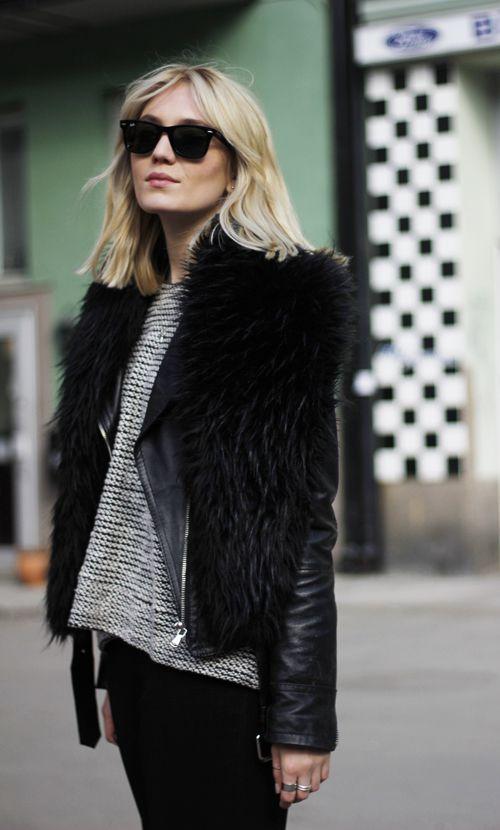 fur vest over leather jacket