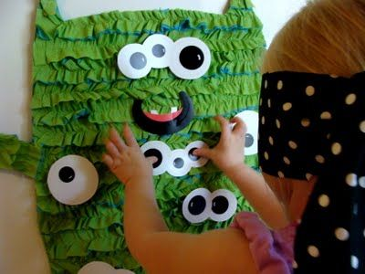 Pin the eyes on the monster. (Also saw these same crepe paper ruffles around party hats - cute.)