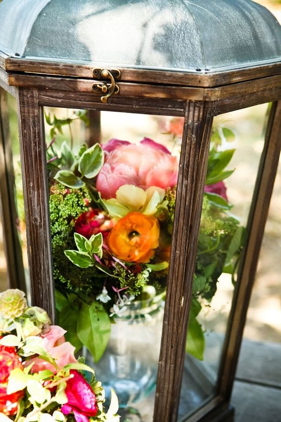Flower arrangements in lanterns! for the patio