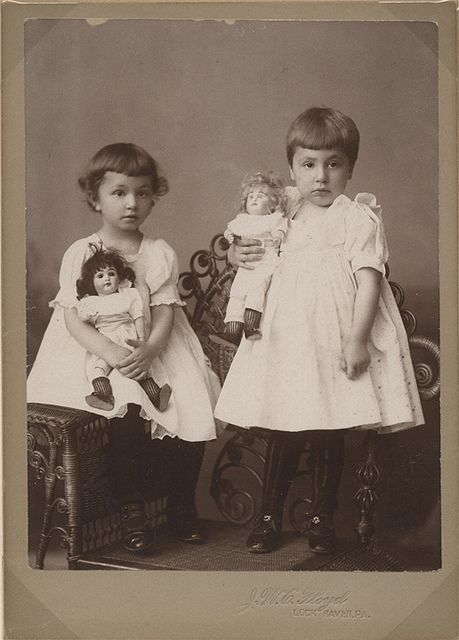 Two Girls with Their Dolls