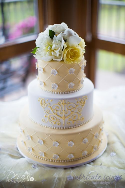 Yellow scroll wedding cake by Intricate Icings Cake Design, photos by @Devon Gregory Gregory Knudson (Devo Photography)