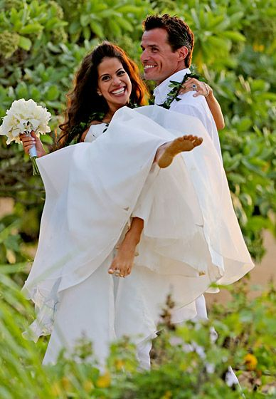 Antonio Sabato, Jr. and Cheryl Moana Marie. The Pacific Blue actor and the former beauty queen swapped vows in Kauai, Hawaii, Sept. 25 2012. The barefoot bride wore a strapless gown with a periwinkle sash, while Sabato wore a white linen shirt and pants.