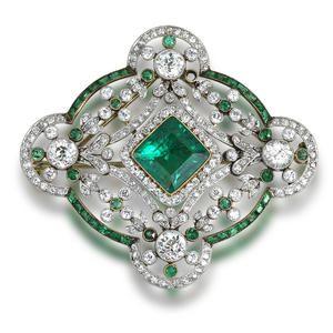 A belle époque emerald and diamond brooch/pendant, circa 1910