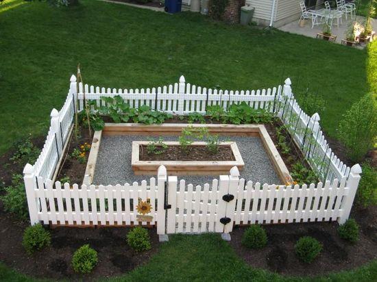 Love this vegetable garden. Cedar raised beds, gravel path, white vinyl fence.