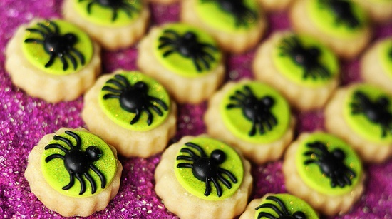 Wonderfully fun little spider topped bite sized cookies. #Halloween #cute #decorated #baking #food #spiders #decorated #autumn #fall #cookies